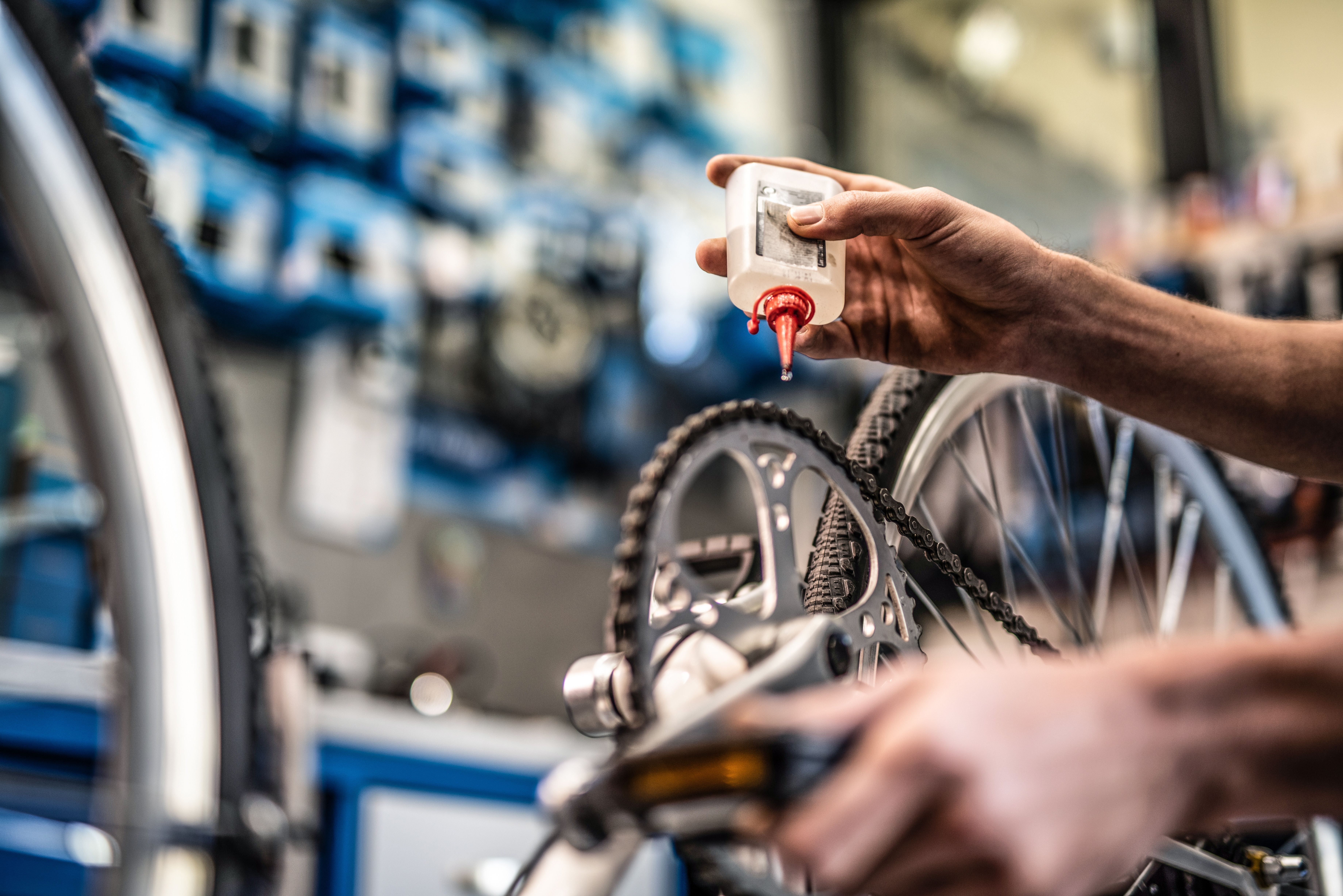 Hands fixing a bike