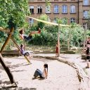 children on playground, made of natural materials